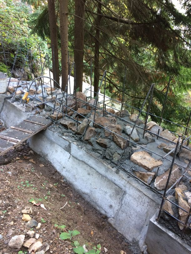 Integrating washed rocks into a retaining wall in Vancouver