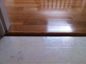 Installed golden oak hardwood floor reducer