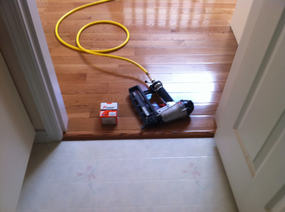 Installed hardwood floor reducer just after nailing